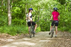 depositphotos_27361497-stock-photo-girls-biking-in-the-forest